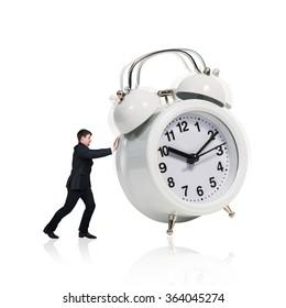Business woman stand near big alarm clock
