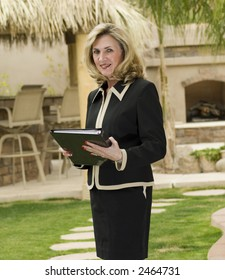 business woman is standing with binder