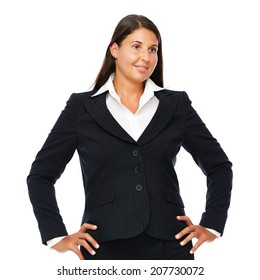 Business woman standing in black suit looking to the right. Isolated on white background.