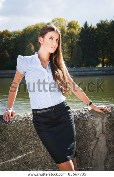 A business woman standing by river in Minsk
