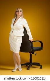 Business woman standing at the chair