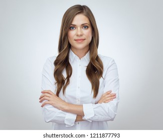 Business woman standing with crossed arms. Isolated studio portrait in white shirt.