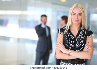 Business woman standing in foreground