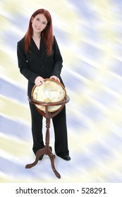 Business Woman Standing with Globe. Shot in studio. Blue and green background.