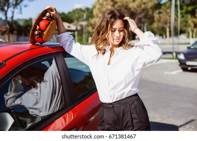 Business woman standing near car.Girl with curly hair,natural make up,woman in white shirt,office manager,transport to work,outdoor portrait,woman looking to a camera,best worker,pretty face
