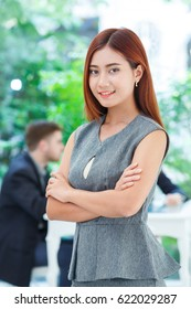 Business woman standing in office with blur background, smart working concept