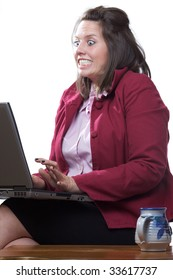 Business woman in state of shock while using her laptop computer; isolated on a white background
