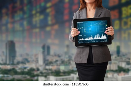 Business woman with stock graph report