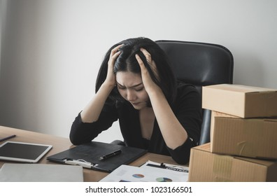 Business woman is stressed out with work on office desk