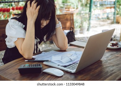 Business woman stressed and worried with a lot of bill.