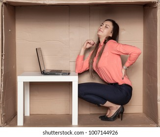 business woman struggles with backache, uncomfortable office