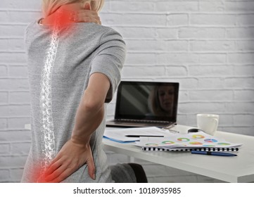 Business Woman suffering from back pain. Incorrect sitting posture problems. Pain relief, chiropractic concept.