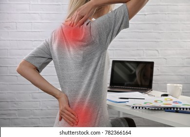 Business Woman suffering from back pain. Incorrect sitting posture problems. Pain relief , chiropractic concept.