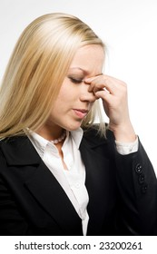 Business woman suffers from a headache on a white background