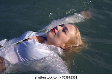 business woman swim in the sea