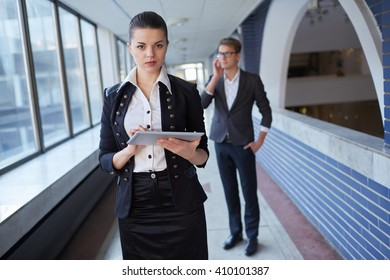 business woman with tablet and businessman with telephone