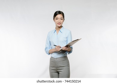 Business woman take note on clipboard