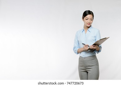 Business woman take note on clipboard,  with copy space for product or text, isolated on white background