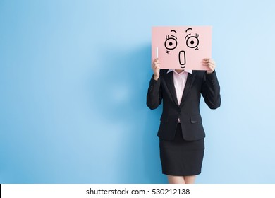 business woman take surprise billboard and speak phone, isolated blue background