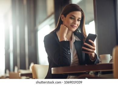 Business woman taking a break in coffee shop