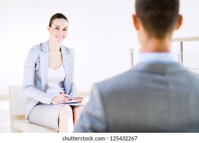 Business woman talking with a colleague in the office