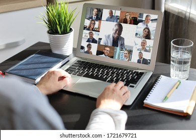 Business woman talking to her colleagues in video conference. Multiethnic business team working from home using laptop.