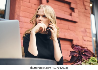 business woman talking on the phone on the building background
