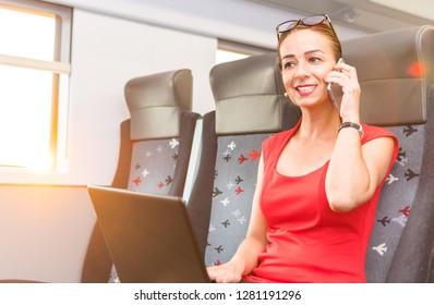 business woman talking on the phone and working with a laptop on the train