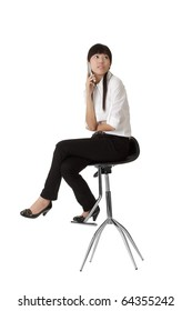 Business woman talking on phone and siting on chair, isolated on white.