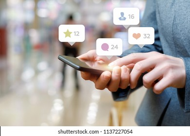 Business woman talking on the social network on blurred background.