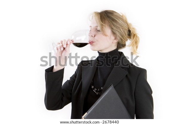 A business woman tasting wine