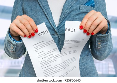 Business woman tearing contract in office - breaking contract
