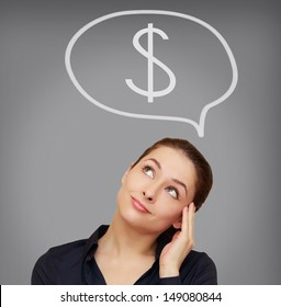 Business woman thinking about dollar currency on grey background