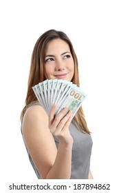 Business woman thinking and holding money isolated on a white background