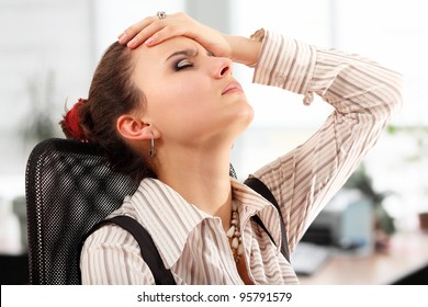 business woman tired depressed in office