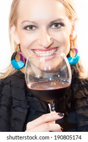 Business woman toasting with a glass of red wine.