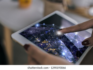 business woman touch the world on the screen tablet,of a sense of science and technology , this image furnished by NASA