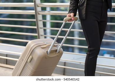 Business woman traveler with modern skywalk background