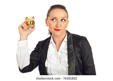 Business woman trying to hear the sound of piggy bank coins isolated on white background