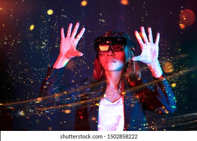 Business woman trying vr glasses hololens with bokeh background in the lab. Mixed reality fantasy future technology concept.