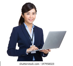 Business woman type on laptop