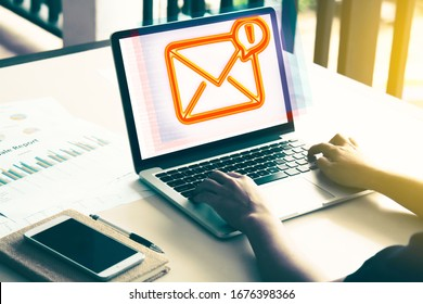 Business woman typing on keyboard , mail issue in laptop