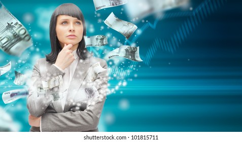 Business woman under a money rain