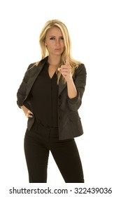 A business woman with an upset expression on her face pointing her finger.