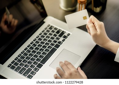 Business Woman use Credit Card to  Shopping Online with Computer Laptop and tablet