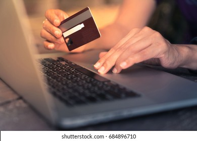 Business Woman use Credit Card to  Shopping Online with Computer Laptop