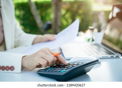 Business woman using calculator for do math finance in office and business working background, tax, accounting, statistics and analytical research concept