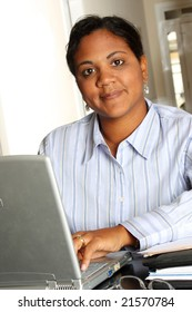 Business woman using a computer at work