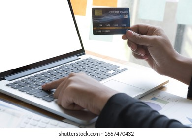 Business woman using credit card for work in the office room, business concept.