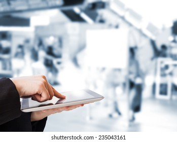 Business woman using digital tablet in the skytrain station